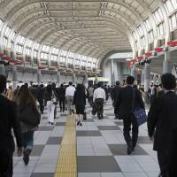 Japan's jobless rate falls to lowest level in over quarter century