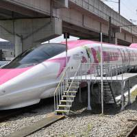 A bullet train with a Hello Kitty motif is shown to the media Monday at a train yard in the city of Fukuoka. | KYODO