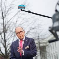 National Economic Council Director Larry Kudlow speaks during an interview in front of the White House in Washington in April. Kudlow, U.S. President Donald Trump's top economics adviser, acknowledged on Sunday the trade dispute with U.S. allies could jeopardize the booming U.S. economy but dismissed criticism of the administration's stance as overblown. | AFP-JIJI