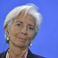 Managing Director of the International Monetary Fund (IMF) Christine Lagarde looks on during a press conference at the Chancellery in Berlin on Monday. | AFP-JIJI