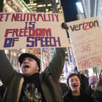 Demonstrators rally in support of net neutrality outside a Verizon store in New York last December. Consumers aren't likely to see immediate changes following the Monday formal repeal of Obama-era internet rules that had ensured equal treatment for all. Rather, any changes are likely to happen slowly, and companies will try to make sure that consumers are on board with the moves, experts say.   AP