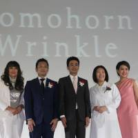 Masaaki Nishikawa (center), president of Japan's Saishunkan Pharmaceutical Co., and other company officials join an event to launch its anti-aging skin care product Domohorn Wrinkle in Bangkok on June 4.   NNA / VIA KYODO