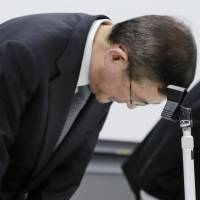 Subaru Corp. President and CEO Yasuyuki Yoshinaga bows in apology during a news conference Tuesday to announce the automaker has found more cases of inspection data falsification. | KYODO