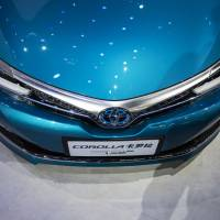 The Toyota Motor Corp. vehicle is displayed in Beijing. Toyota Motor Corp. and KDDI Corp. have persuaded several other Japanese carmakers to test and deploy connected-car technology. | BLOOMBERG