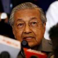 Malaysia's Mahathir calls for review of Trans-Pacific trade pact