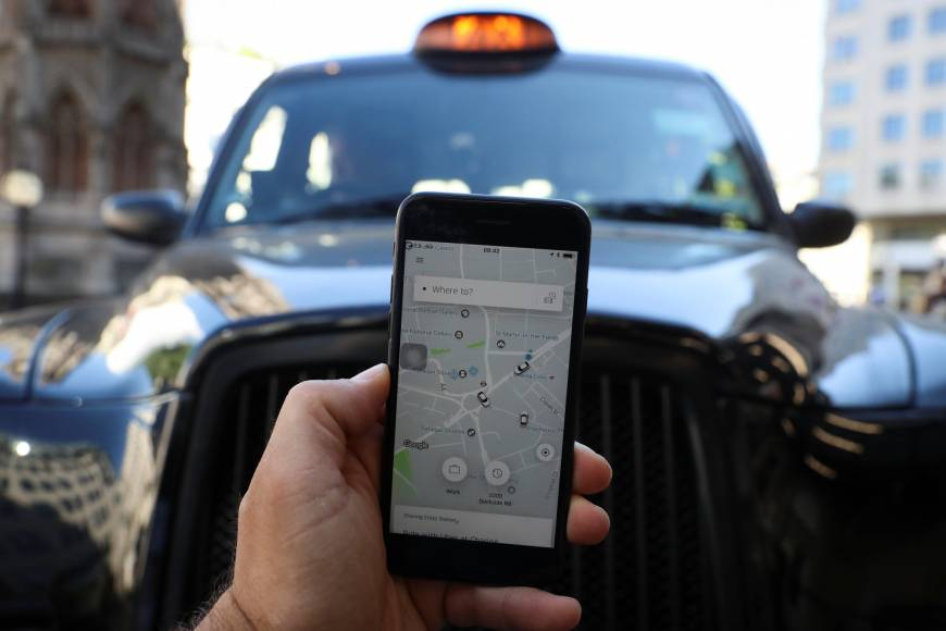 Put on probation, Uber wins London license to avoid ban