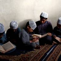 Afghan boys read the Koran in a madrasa, or religious school, in Kabul on May 28. | REUTERS