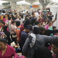 Undeterred by Trump, asylum-seekers line up at Mexican border, sleep rough for days
