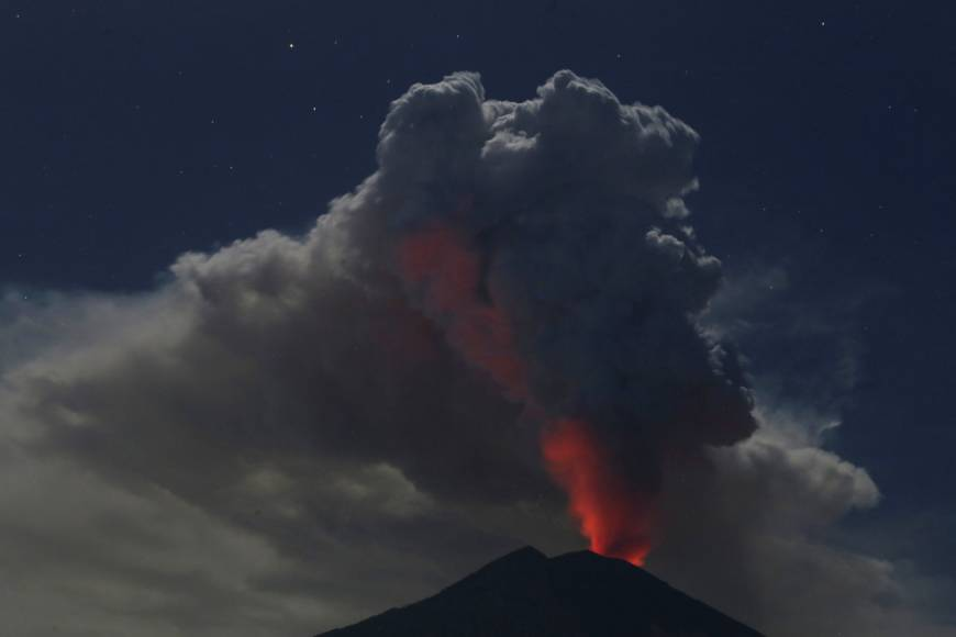 Bali shuts airport amid volcanic eruption after pilot detects ash at altitude