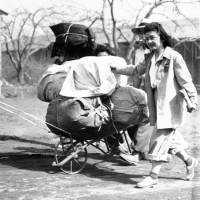 Japanese-Americans move into the internment camp in Manzanar, California, in June 1942. Roughly 120,000 Japanese-Americans were sent to the desolate camps that dotted the West during World War II because the government claimed they might plot against the U.S. | AP