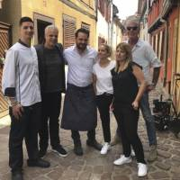 This handout image taken on June 4 and released by Jean-David Schroeder on Friday shows Julien Schroeder (center), the chef of the Petite Venise restaurant in Colmar, eastern France, posing with his wife, Virginie Schroeder (center right), Eric Ripert (second left) and Anthony Bourdain (right). A prosecutor in France says Anthony Bourdain apparently hanged himself in a luxury hotel in the small town of Kaysersberg. French media quoted Colmar prosecutor Christian de Rocquigny du Fayel as saying that 'at this stage' nothing suggests another person was involved in the death Friday of the American celebrity chef and food writer. | JEAN-DAVID SCHROEDER / VIA AP