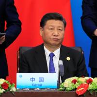 Chinese President Xi Jinping attends a signing ceremony during the Shanghai Cooperation Organization summit in the port city of Qingdao, in northeast China, on Sunday. | REUTERS