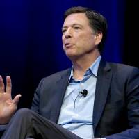Former FBI director James Comey speaks during a stop on his book tour in Washington in April. Comey is about to get dinged in an internal review by the Justice Department, and President Donald Trump says he can't wait. | AP