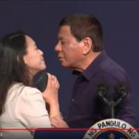 Philippine President Rodrigo Duterte kissed a Filipino woman on lips while on an official visit in South Korea on Sunday in this screenshot taken from YouTube.