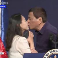 Philippines' Rodrigo Duterte says he will quit if enough women protest his kiss with an overseas worker in Seoul