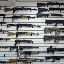 Dozens of semi-automatic rifles fill a wall in a gun shop in Lynnwood, Washington, last November. A new study by the Small Arms Survey released Monday of small arms estimates there are over 1 billion legal and illicit firearms in the world today, including 857 million in civilian hands — with American men and women the dominant owners.