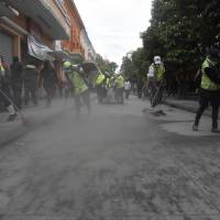 Municipal employees sweep up ash after the eruption of the Fuego Volcano, in Guatemala City on Sunday. | AFP-JIJI