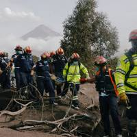 Rescuers comb smoldering ash in search for 200 missing near Guatemala volcano as death toll hits 85