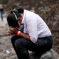 For kin of Guatemala volcano victims, the wait to find and ID dead kin agonizing