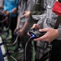 A man plays a game at the Paris Games Week in Paris last November. The World Health Organization says that compulsively playing video games now qualifies as a new mental health condition, in a move that some critics warn may risk stigmatizing young players. | AP