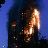 A huge fire engulfs the Grenfell Tower in west London on June 14, 2017. | AFP-JIJI