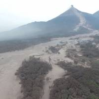 The aftermath of a volcanic eruption in Escuintla, Guatemala, is seen in this picture obtained Monday from social media. | MINGOB / PNC / VIA REUTERS