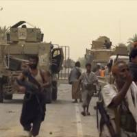 Saudi-led forces gather Saturday to retake the international airport of Yemen's rebel-held port city of Hodeida from the Shiite Houthi rebels. | ARAB 24 / VIA AP