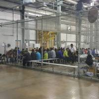 A view of inside U.S. Customs and Border Protection (CBP) detention facility shows detainees inside fenced areas at Rio Grande Valley Centralized Processing Center in Rio Grande City, Texas, on June 17. | REUTERS