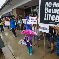 People gather in Mishawaka, Indiana, on Thursday to protest the separation of migrant children from their families at the border. | AP