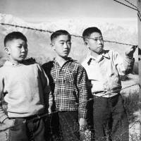 Japanese-American children stand at a fence at the Manzanar internment camp in Independence, California. The camp was in operation from December 1942 to November 1945. | AP