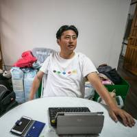 Shin Kang-hyob, an activist at the Jeju NGO Network for Refugee Rights, speaks during an interview in Jeju, South Korea, on Thursday.   BLOOMBERG