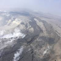 This Saturday aerial photo provided by the U.S. Geological Survey shows cracking and slumping of the Halema'uma'u crater walls. | U.S. GEOLOGICAL SURVEY / VIA AP
