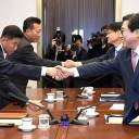 South Korea's chief delegate Jeon Choong-ryul (right) shakes hands with his North Korean counterpart Won Kil U (left) during their talks on athletics on Monday at the south side of the truce village of Panmunjom in the Demilitarized zone dividing the two Koreas.