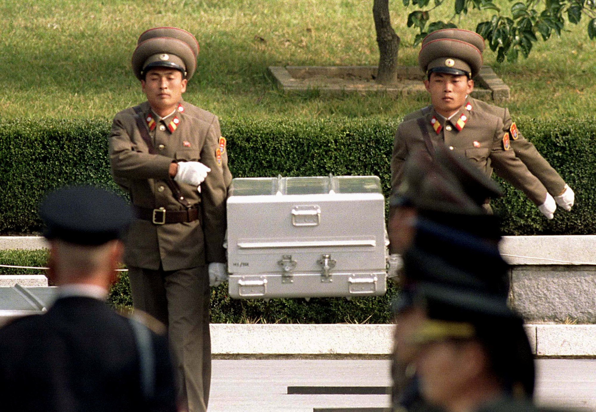North Korean soldiers carry a coffin believed to contain the remains of a U.S. soldier to the border with South Korea during repatriation ceremonies at the truce village of Panmunjom  in October 1998.   REUTERS