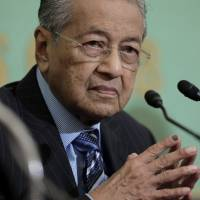 Malaysia's top two judges resign as new government purges top officials