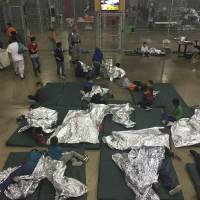 Hundreds of immigrant kids held in fenced cages at Texas border facility