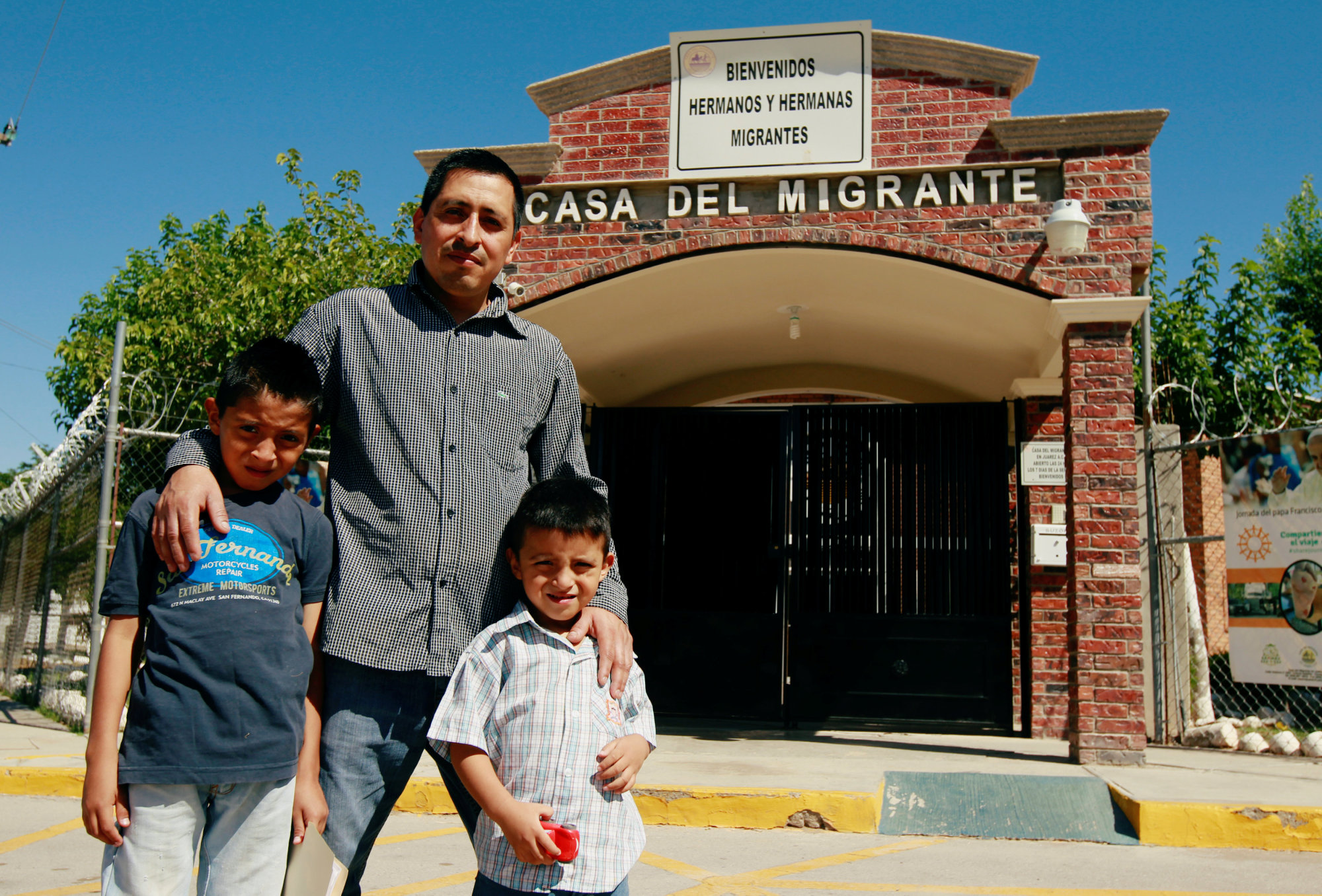 Salvadoran migrant Epigmenio Centeno and his sons, 9-year-old Axel Jaret and 3-year-old Steven Atonay, pose outside the shelter House of the Migrant in Ciudad Juarez, Mexico, on Tuesday after Epigmenio decided to stay with his children in Mexico due to U.S. President Donald Trump's child separation policy. | REUTERS