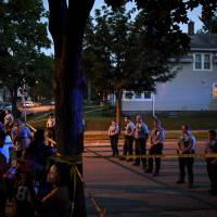 Authorities probe fatal Minneapolis police shooting amid conflicting claims over  whether black victim was armed