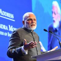 Indian Prime Minister Narendra Modi delivers the keynote address at the Shangri-La dialogue in Singapore on Friday. Modi called for countries to have 'equal access' to shared maritime and air spaces, and for regional disputes to be settled under international law. | AFP-JIJI