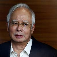 Former Malaysian Prime Minister Najib Razak arrives to give a statement to the Malaysian Anti-Corruption Commission (MACC) in Putrajaya, Malaysia, on May 24. | REUTERS