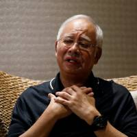 In interview, Malaysia's Najib says advisers hid corruption from him