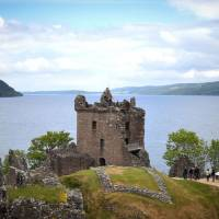 Tourists take in Urquhart Castle on the banks of Loch Ness in the Scottish Highlands on June 10. | AFP-JIJI
