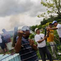 Nicaraguan bastion defies government siege to bury dead blamed on state-backed 'assassins'