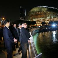 North Korean leader Kim Jong Un looks out from the Jubilee Bridge during a tour in Singapore on Monday. | AFP-JIJI