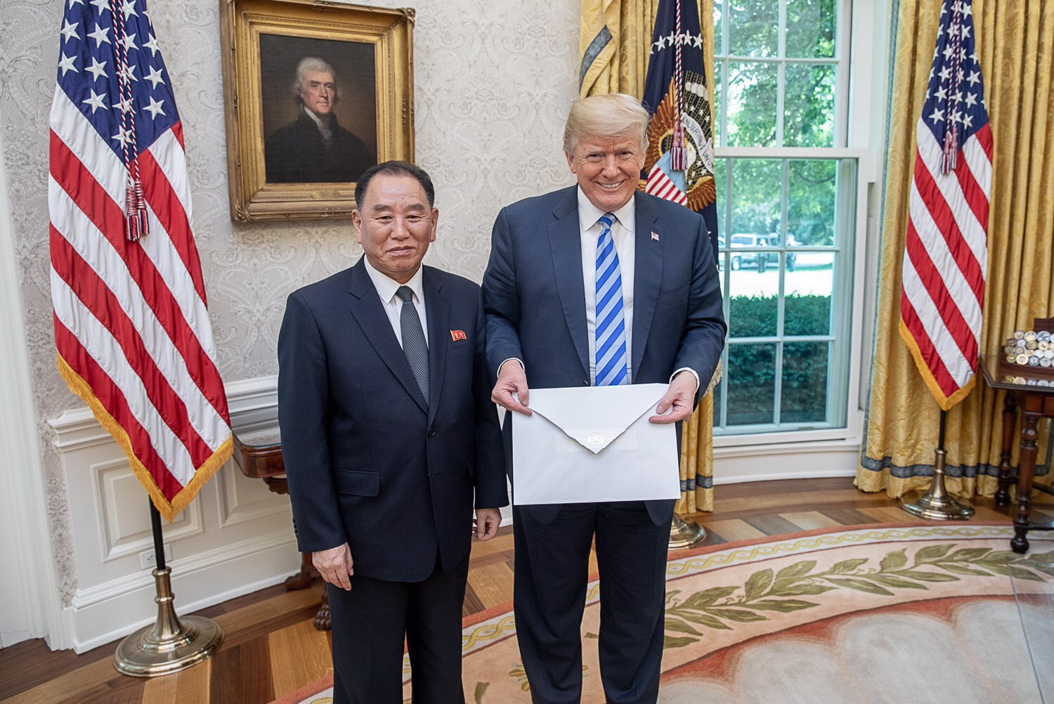U.S. President Donald Trump is presented with a letter from North Korean Leader Kim Jong Un by Kim's envoy, Kim Yong Chol, in Washington on Friday. | SHEALAH CRAIGHEAD / VIA WHITEHOUSE PHOTOS