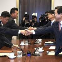 Two Koreas discuss how to cooperate in Asian Games as cancellation of 'large-scale' U.S.- South Korea military appears imminent