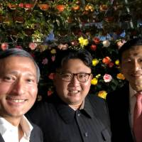 North Korean leader Kim Jong Un, Singaporean Foreign Minister Vivian Balakrishnan (left) and Education Minister Ong Ye Kung pose for a selfie posted to Balakrishnan's official Twitter account in the city-state late Monday. | REUTERS