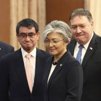 U.S. Secretary of State Mike Pompeo (right) attends a meeting with South Korean Foreign Minister Kang Kyung-wha (center) and Japanese Foreign Minister Taro Kono at the South Korean Foreign Ministry in Seoul on Thursday.   AP