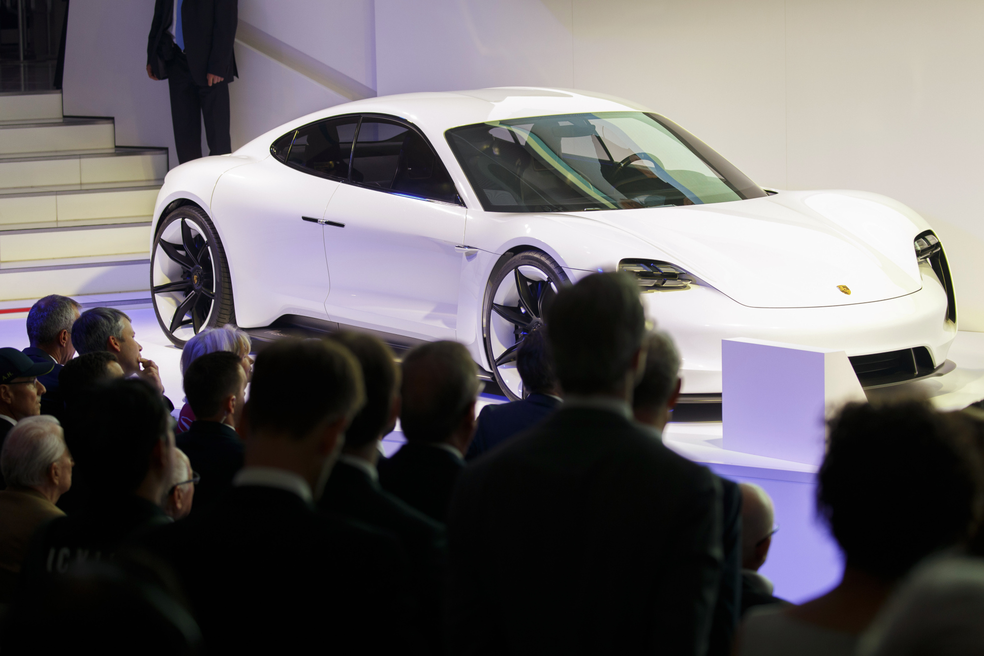 A Porsche AG Taycan electric automobile sits on display as the luxury automaker celebrates its 70th anniversary in Stuttgart, Germany, on Friday. Porsche AG named its first car to directly compete with electric leader Tesla Inc. the Taycan, as the German manufacturer gears up for what will arguably be its most ambitious and potentially risky vehicle project ever.   BLOOMBERG