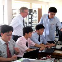 Students of Pyongyang University of Science and Technology attend a class in Pyongyang.   REUTERS